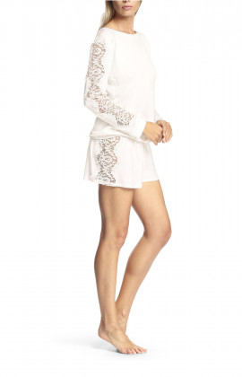 Pyjamas comprising long-sleeved top and shorts with lace inserts