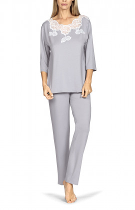 Two-piece pyjamas comprising a top with three-quarter sleeves and lace insert, and long trousers.