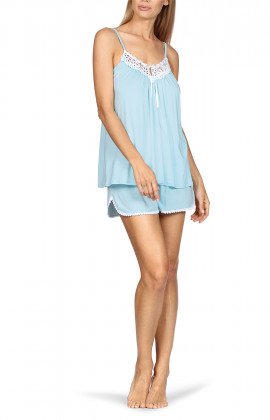 Nightset comprising a top with thin straps and loose-fitting shorts.