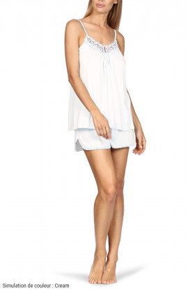 Nightset comprising a top with thin straps and loose-fitting shorts. Coemi-lingerie