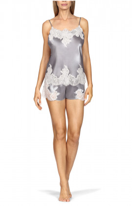 Two-piece nightset comprising a satin and lace strappy top and shorts.