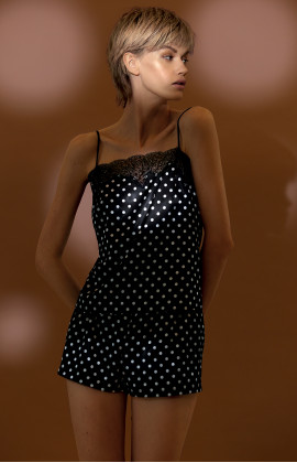 Two-piece nightset comprising a polka dot pattern satin and lace top and shorts.