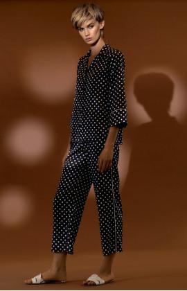 Two-piece satin pyjamas with polka dot pattern shirt top.