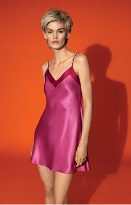 Strappy satin slip dress with two-tone neckline.