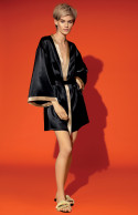 Two-tone satin kimono with loose-fitting flared three-quarter sleeves.