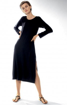 Long calf-length dress with round neck and long sleeves.